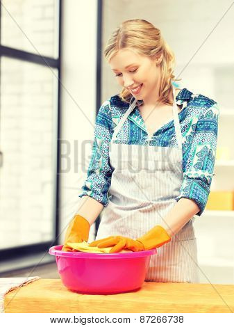 picture of beautiful housewife washing dish at the kitchen ..