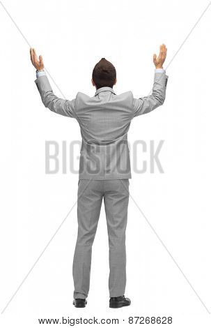 business, people, gesture, success and office concept - businessman raising hands up from back