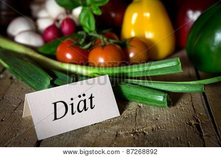 Different Vegetables On A Old Wooden Table, Card With Word Diät