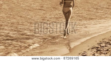 Woman is running on the coast