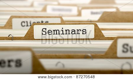 Seminars Concept with Word on Folder.