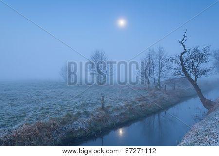 Moon Shine Over Foggy Meadow And River