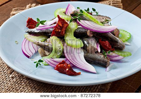 Herring salad with sun-dried tomatoes, celery and red onion