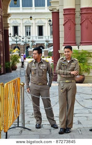 Guards Stand In Front Of The Grand Palace In Bangkok, Thailand
