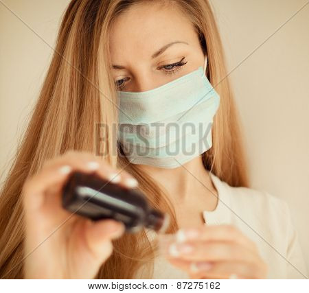 Woman In Mask Hand Holding Medicine
