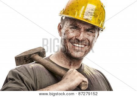 Young Dirty Worker Man With Hard Hat Helmet  .holding A Hammer