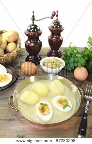 Fresh Sharp Mustard Eggs With Sauce And Potatoes