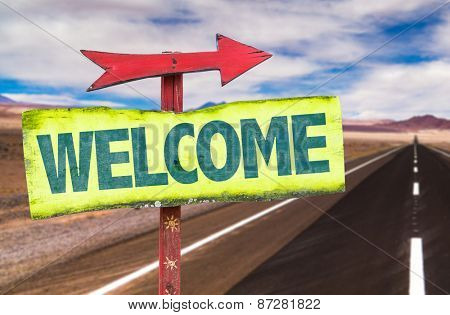 Welcome sign with road background