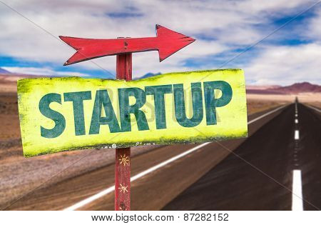 Startup sign with road background