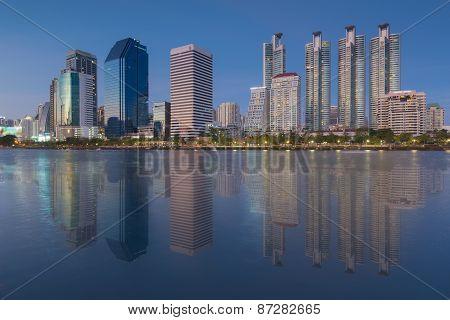 Twilight time at Bangkok city downtown with reflection of skyline, Bangkok,Thailand