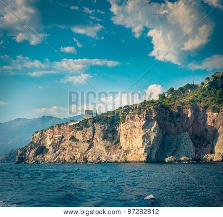 The high cliffs next to the central beach of Budva make the coastline even more scenic and romantic for boat trips, Montenegro.