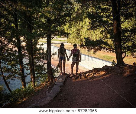 Couple in Morning light with sea on background