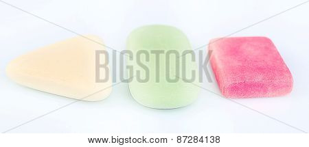 Three erasers isolated on white