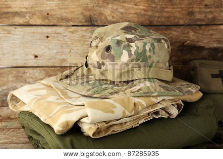 Pack gear for hike on wooden background
