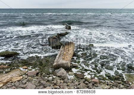 Broken Concrete Slabs On The Rocky Shore