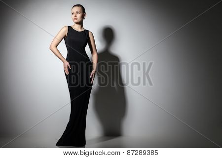 beautiful woman model posing in elegant black dress