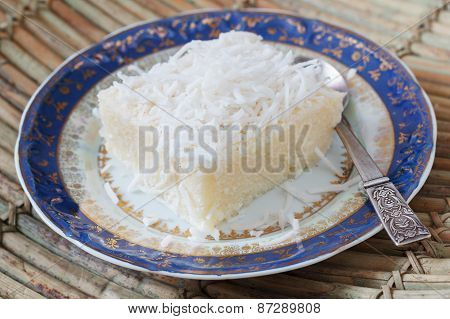 Rice Pudding With Coconut On Blue Vintage Plate With Spoon On Wooden Table