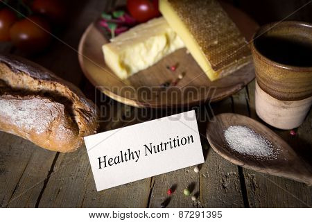 Cheese, Bread, Salt And Vegetables On A Wooden Table, Card With Healthy Nutrition