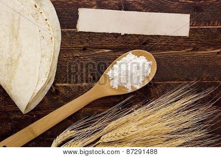 Flour In A Spoon And Tortillas