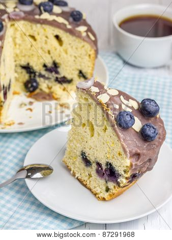 Piece Of Homemade Blueberry Cake With Icing And Berry On Top