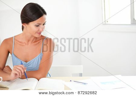 Pretty Woman Studying Her Books At Home