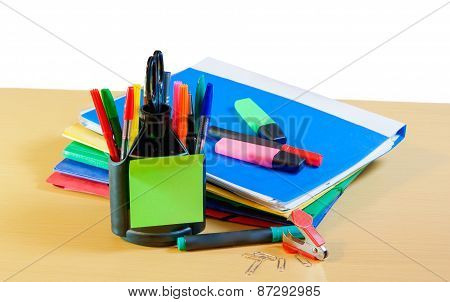 Group Of Multicolored Office Folders, Glasses And Office Supplies