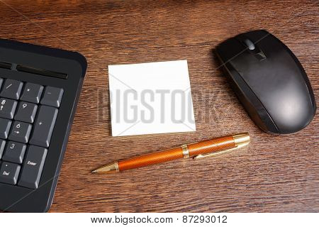 Composition With Sticker,  Mouse, Pen And Keyboard Laying On Wooden Desk