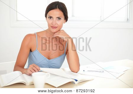 Pretty Latin Woman Working While Sitting