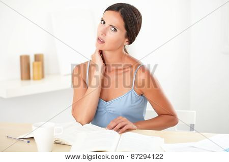 Attractive Woman Looking Fatigued While Reading