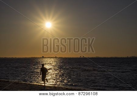 Man Jogging on the Beach During Sunrise
