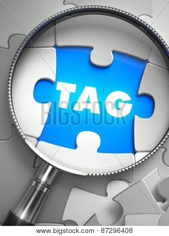 Tag - Missing Puzzle Piece through Magnifier.