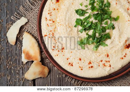 Hummus healthy eastern creamy lunch served with pita, paprika and parsley