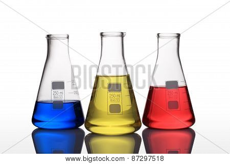 Laboratory Glassware With Blue,yellow And Red Liquid