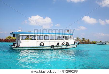 Maldivian water taxi cruising between islands