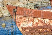 pic of shipwreck  - The fore of a rusty old shipwreck with ropes hanging - JPG