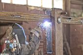 image of gases  - Welder brews metal structure in the shop - JPG