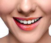 stock photo of close-up shot  - Smiling happy woman with colorful lips make up looking at the camera - JPG