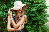 image of lip  - beautiful sexy woman in elegant hat with red lips and black polka - JPG