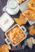 stock photo of porridge  - pumpkin porridge in the bowl and on a table - JPG