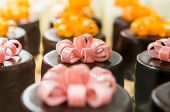 picture of eatables  - a lot of small chocolate cakes with eatable bows - JPG