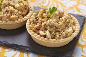 stock photo of cod  - Salad with cod liver - JPG