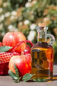 stock photo of vinegar  - Apple cider vinegar with a fresh apple - JPG