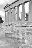 stock photo of parthenon  - The ruins of the Parthenon reflected in a puddle on the Acropolis - JPG