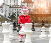 stock photo of chess piece  - Chess game with giant chess piece - JPG