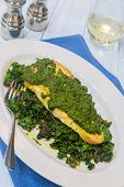 picture of sauteed  - Sauteed fish topped with pesto on a bed of sauteed kale - JPG