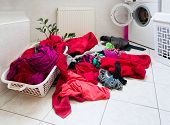 image of dirty-laundry  - pile of dirty clothes ready for the wash in home bathroom - JPG