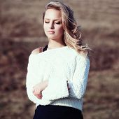 picture of pullovers  - Portrait of a beautiful young blonde girl in the white pullovers - JPG