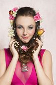 foto of silver-hair  - Pretty natural cheerful model with brown curly hair with spring flowers - JPG