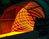 foto of manufacturing  - manufacturing wire Steel Works orange fire red - JPG