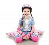 foto of roller-skating  - Cute smiling little girl in pink roller skates and protective gear isolated on a white - JPG